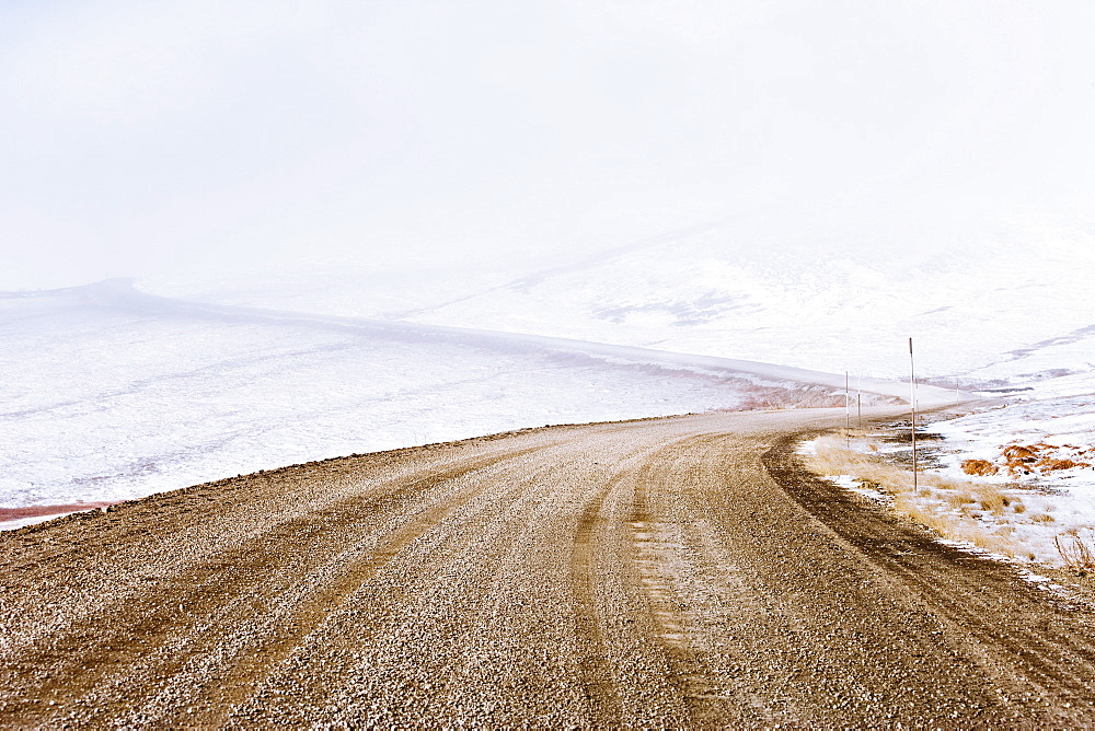 Snow along Dempster Highway and fog over Richardson Mountains, Yukon