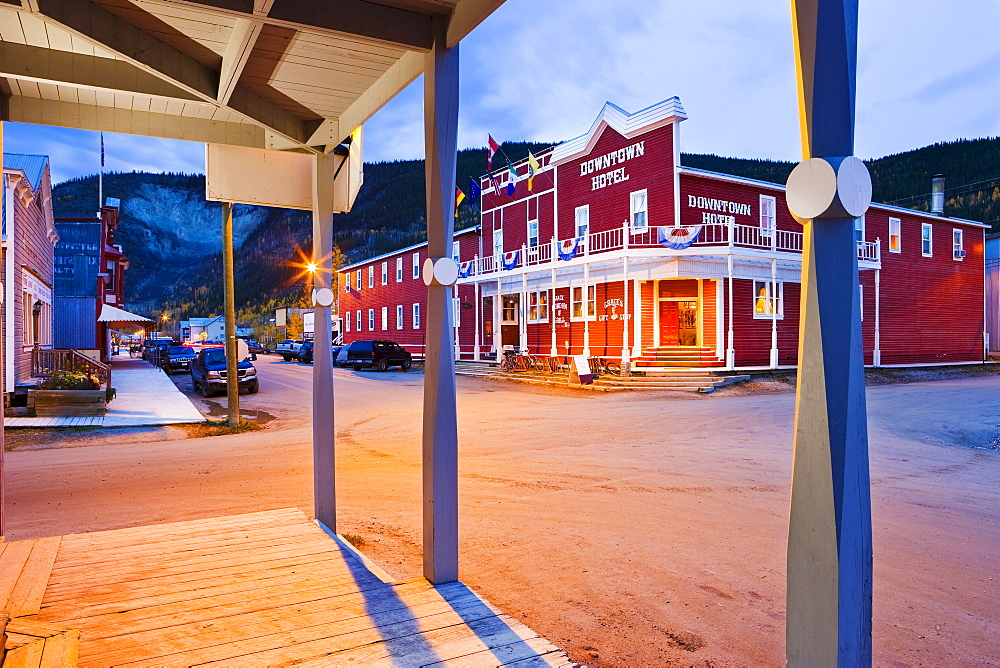 Hotel and houses on Second Ave at dusk, Dawson City, Yukon