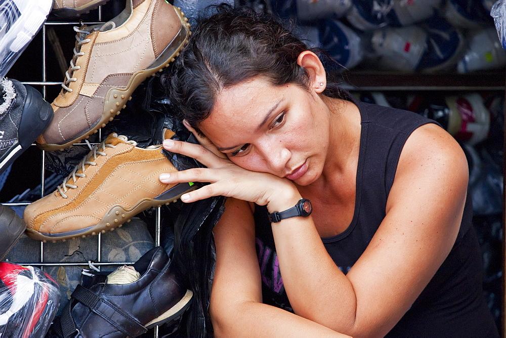 Woman resting in a shoe store, Guayaquil, Guayas, Ecuador