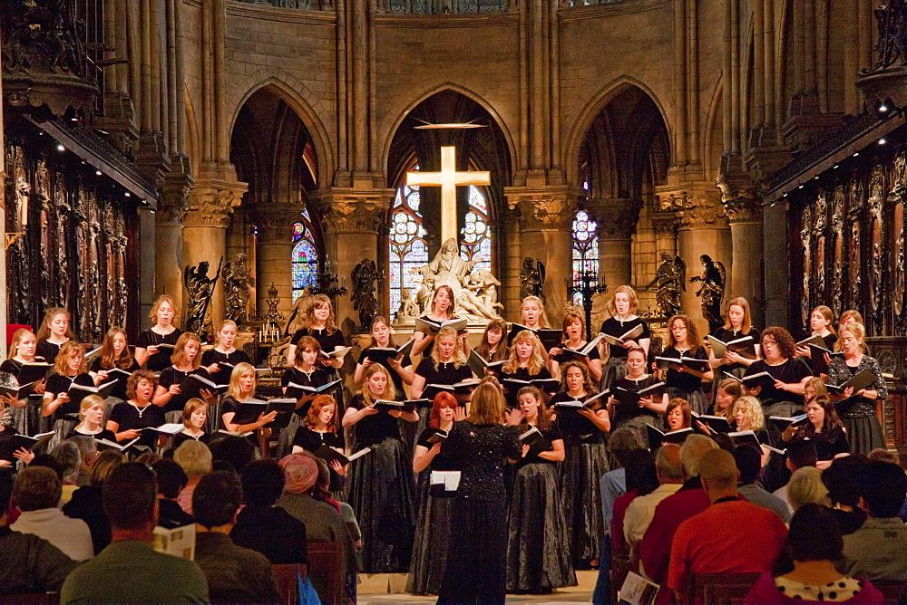 Choir performing during a mass in Notre Dame de Paris Cathedral, Paris, France