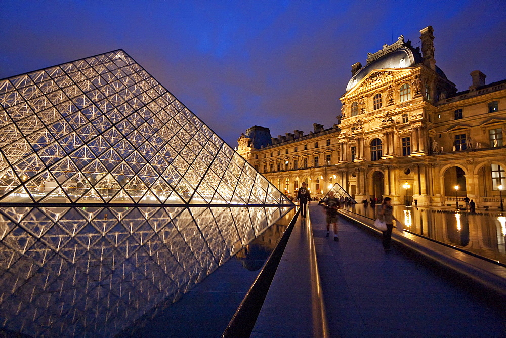 Louvre Pyramid by the architect I.M. Pei and Richelieu Wing of the Louvre Museum at night, Paris, France