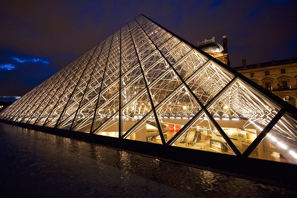 Louvre Pyramid by the architect I.M. Pei at night, Paris, France