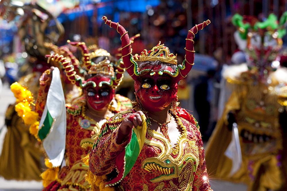 Diablada dancers wearing elaborate devil masks and costumes in the procession of the Carnaval de Oruro, Oruro, Bolivia