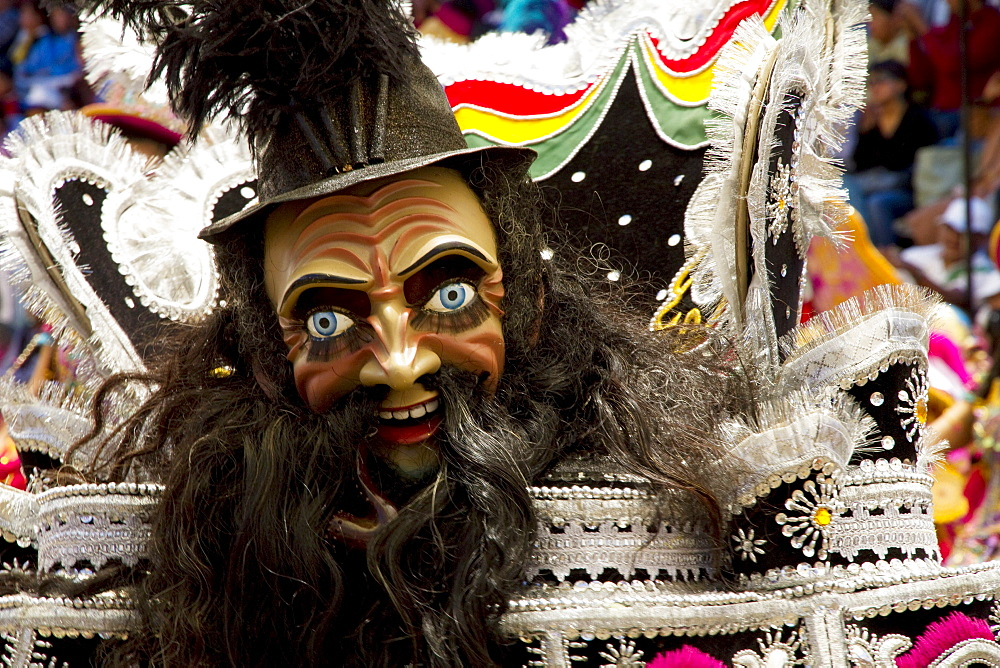 Morenada dancer wearing an elaborate mask and costume in the procession of the Carnaval de Oruro, Oruro, Bolivia - 1116-26064