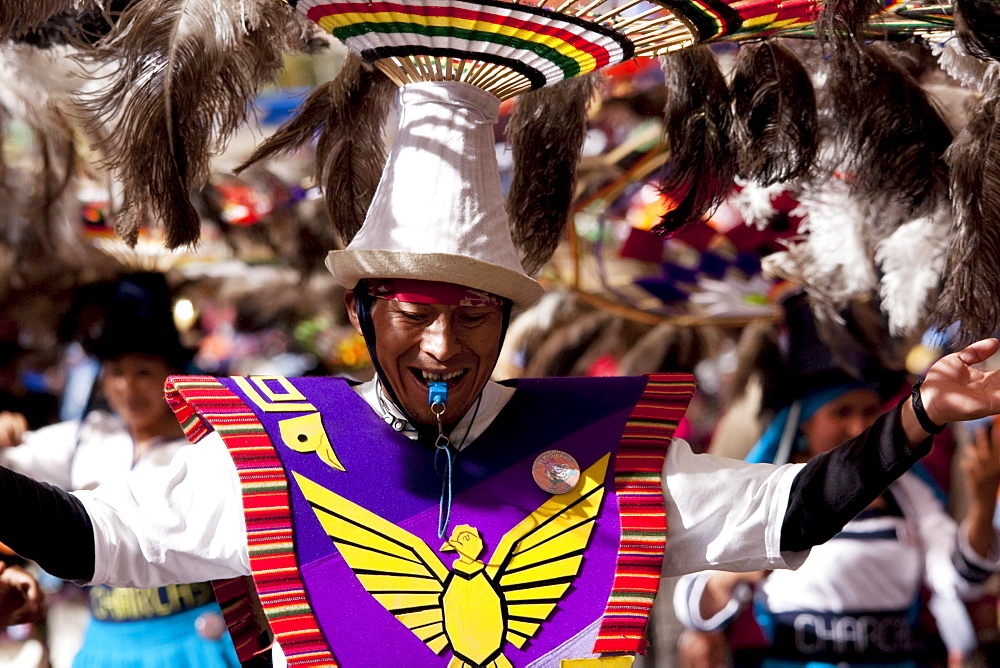 Suri Sicuri dancer wearing an elaborate feather headdress in the procession of the Carnaval de Oruro, Oruro, Bolivia