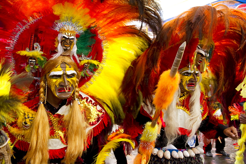 Tobas dancers wearing elaborate masks, feather headdresses and costumes in the procession of the Carnaval de Oruro, Oruro, Bolivia - 1116-26125