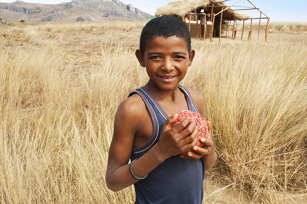 Boy with homemade football Anja, Fianarantsoa Province, Madagascar