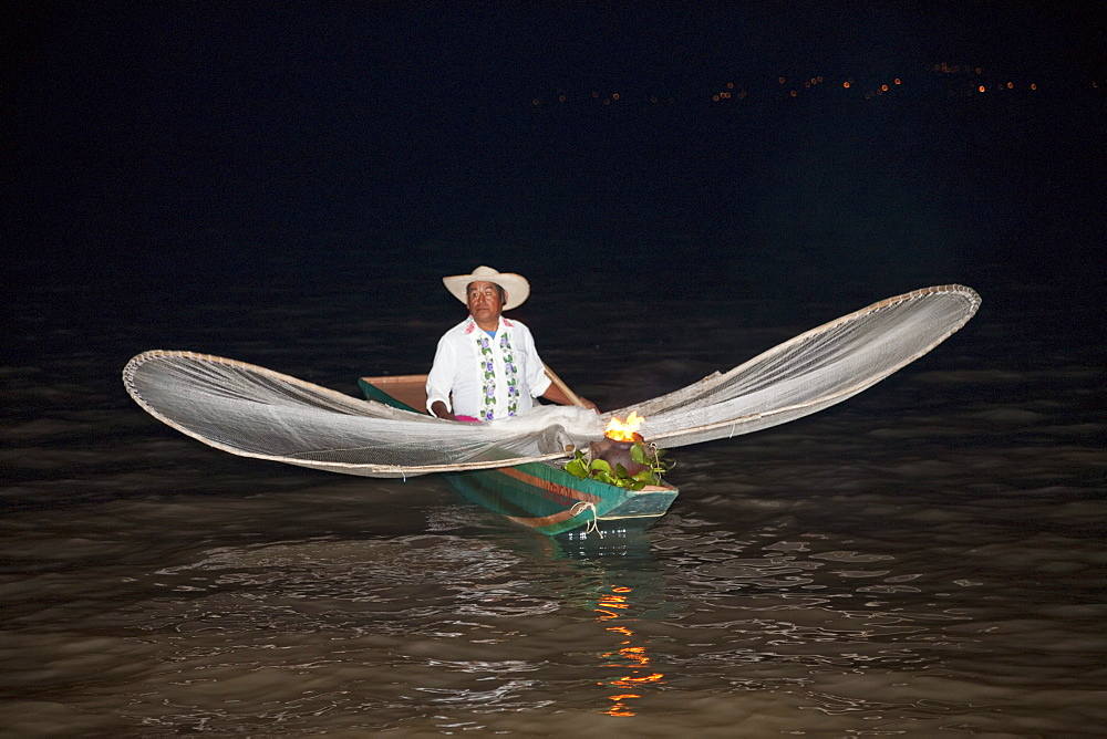 Fisherman with butterfly nets in Lake Pátzcuaro at night, Michoacán, Mexico