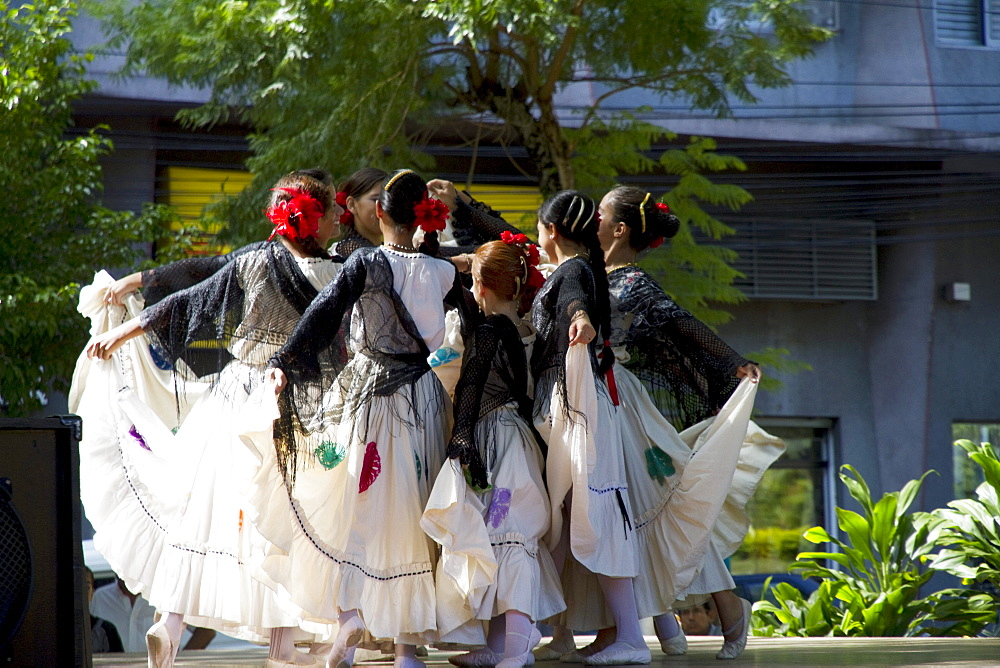 Girls wearing traditional dress performing a Paraguayan polka, Asuncion, Paraguay