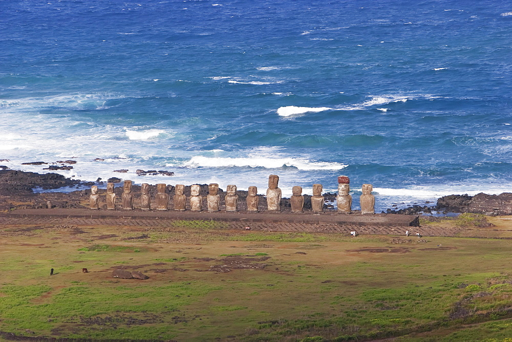 Fifteen moais from different periods, restored by archaeologist Claudio Cristino, at Ahu Tongariki, as seen from Rano Raraku, Rapa Nui (Easter Island), Chile
