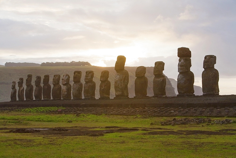 Fifteen moais from different periods, restored by archaeologist Claudio Cristino, at Ahu Tongariki at dawn, Rapa Nui (Easter Island), Chile