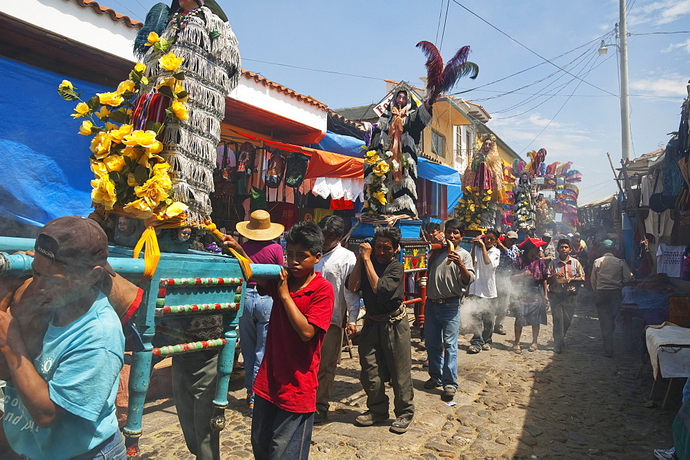 On Easter Sunday the comrades (council men) carry the andas (floats) of the saints in procession through the streets of Chichicastenango, El Quichu, Guatemala - 1116-27152