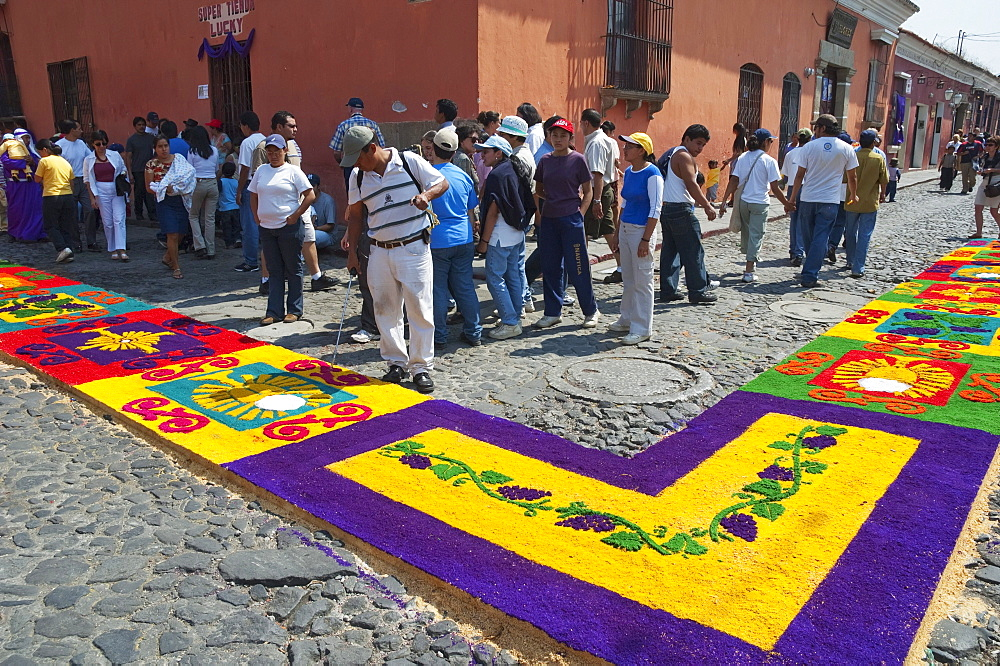 Carpet made of sand & sawdust along the Good Friday processional route. Carpet-making is thought of as a sacrificial act, as the elaborate detail and time that go into the carpet making is a way for people to give something of themselves in memory of the crucifixion of Jesus. These carpets last on average 2 hours before they are destroyed by the many feet that march over them during a procession in Antigua Guatemala., Sacatepuquez, Guatemala