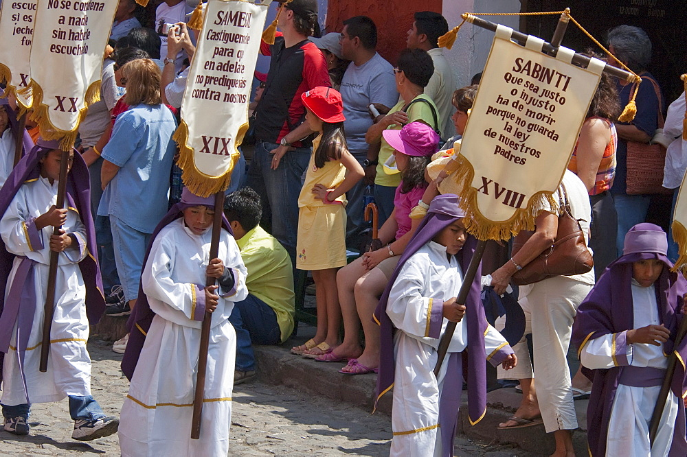 Children carrying standards at the Procession of the Holy Cross on Good Friday in Antigua Guatemala, Sacatepuquez, Guatemala