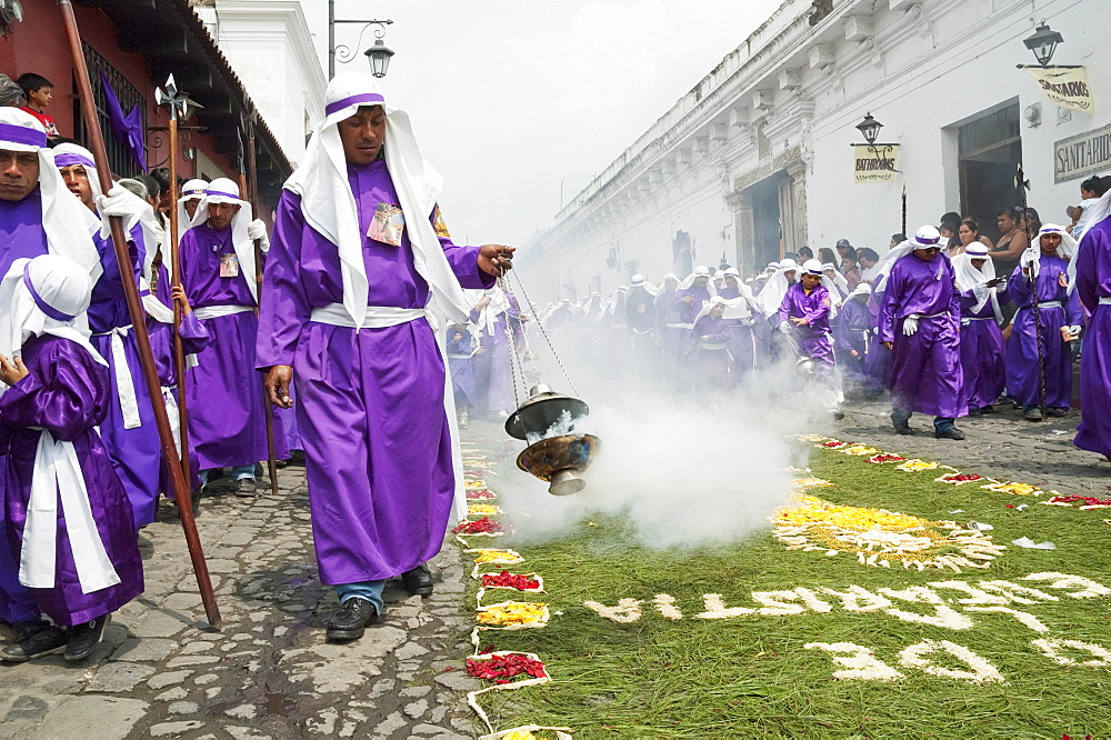 Men and boys wear purple as a sign of mourning at the Procession of the Holy Cross on Good Friday in Antigua Guatemala, Sacatepuquez, Guatemala - 1116-27231