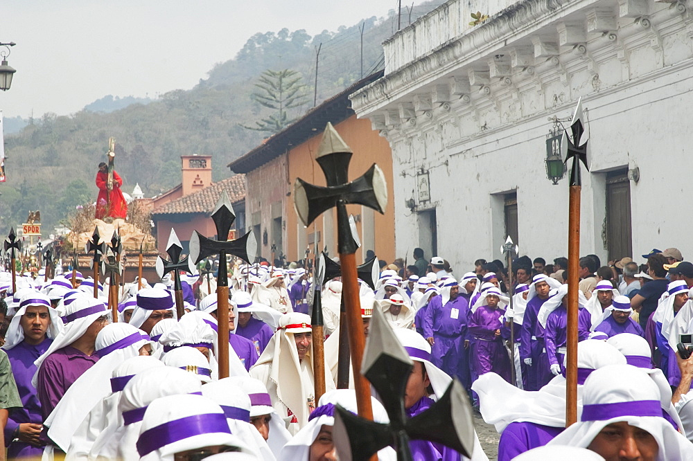Men carrying the anda (float) of Jesus carrying the Cross during the Procession of the Holy Cross on Good Friday in Antigua Guatemala, Sacatepéquez, Guatemala - 1116-27234