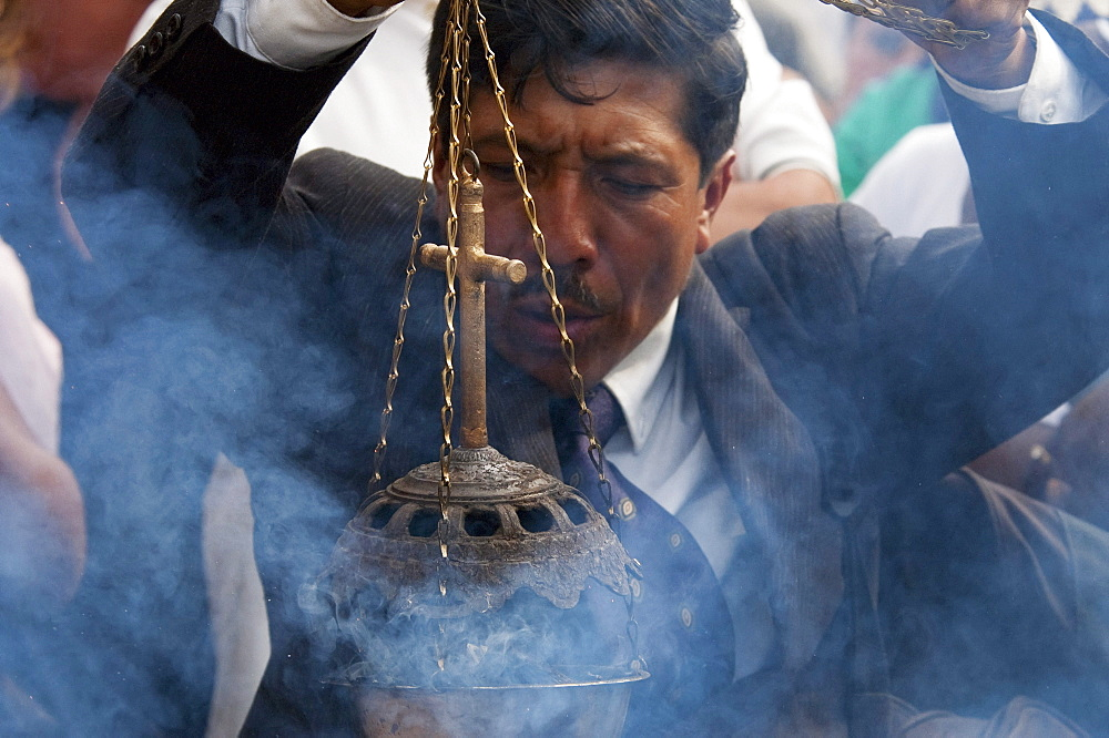 Man waiving an incense burner during the Holy Burial Procession on Good Friday in Antigua Guatemala, Sacatepuquez, Guatemala - 1116-27270