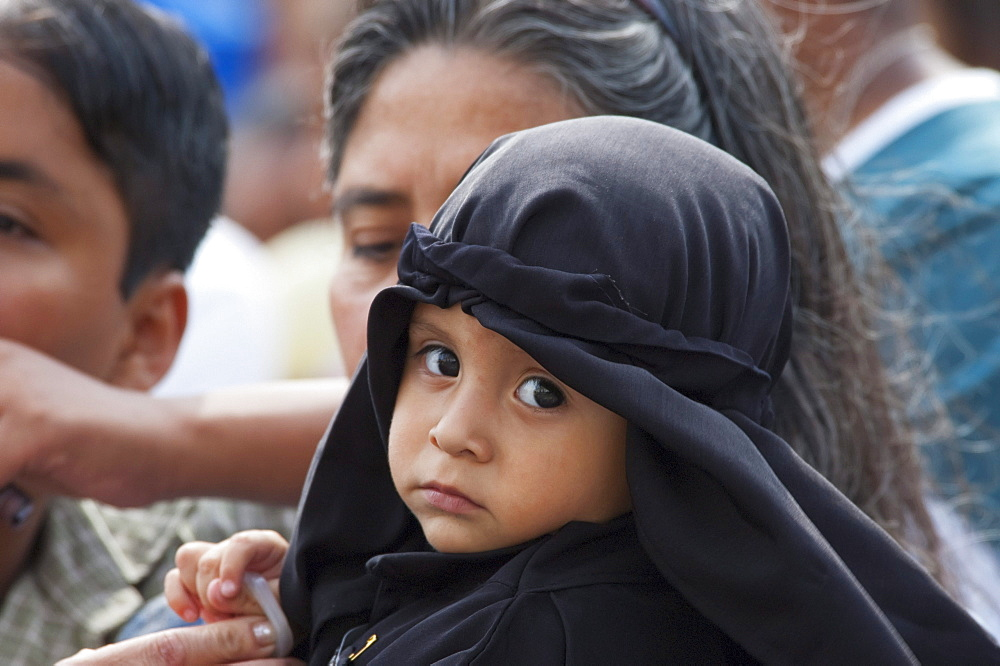 Little boy dressed in mourning at the Holy Burial Procession on Good Friday in Antigua Guatemala, Sacatepéquez, Guatemala - 1116-27348