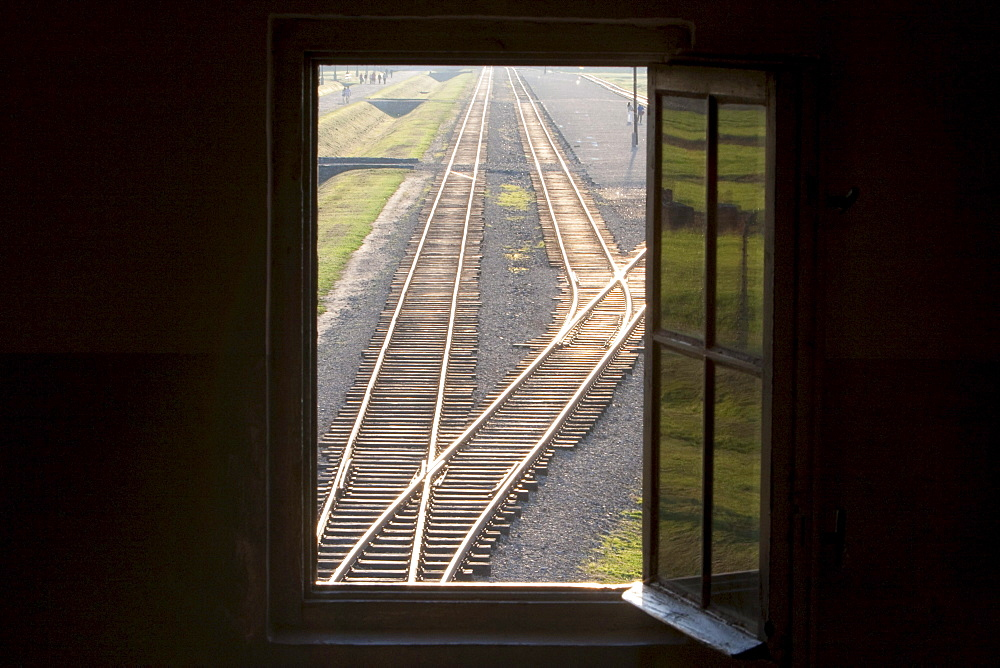 View of the railway track along the 'Selektionsrampe', the platform where people where selected to die in the gas chambers immediately or to work to death from the main guard house (Gate of Death), Auschwitz-Birkenau Concentration Camp, Oswiecim, Malopolska, Poland
