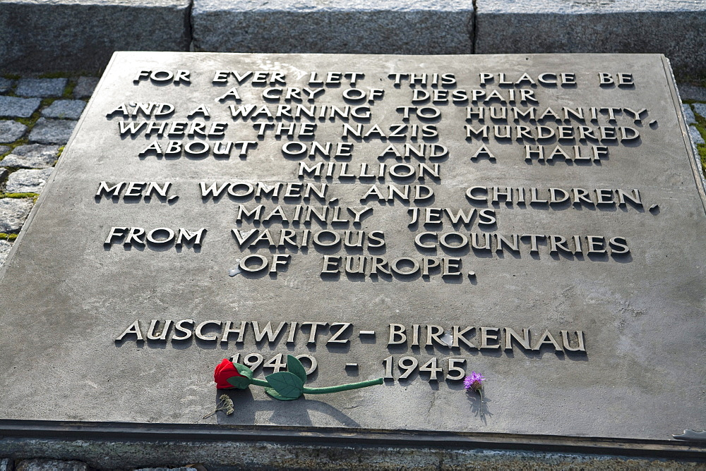 Memorial stating 'For ever let this place be a cry of despair and a warning to Humanity, where the Nazis murdered about one and a half million men, women and children, mainly Jews from various countries of Europe' at the Auschwitz-Birkenau Concentration Camp, Oswiecim, Malopolska, Poland