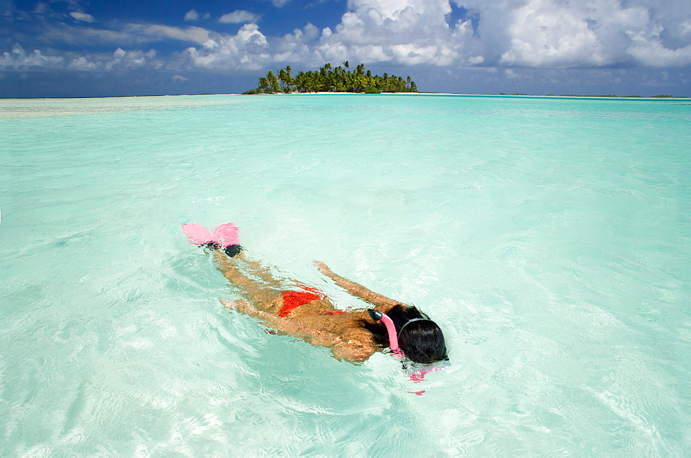 French Polynesia, Woman snorkeling in tropical ocean water. - 1116-27988