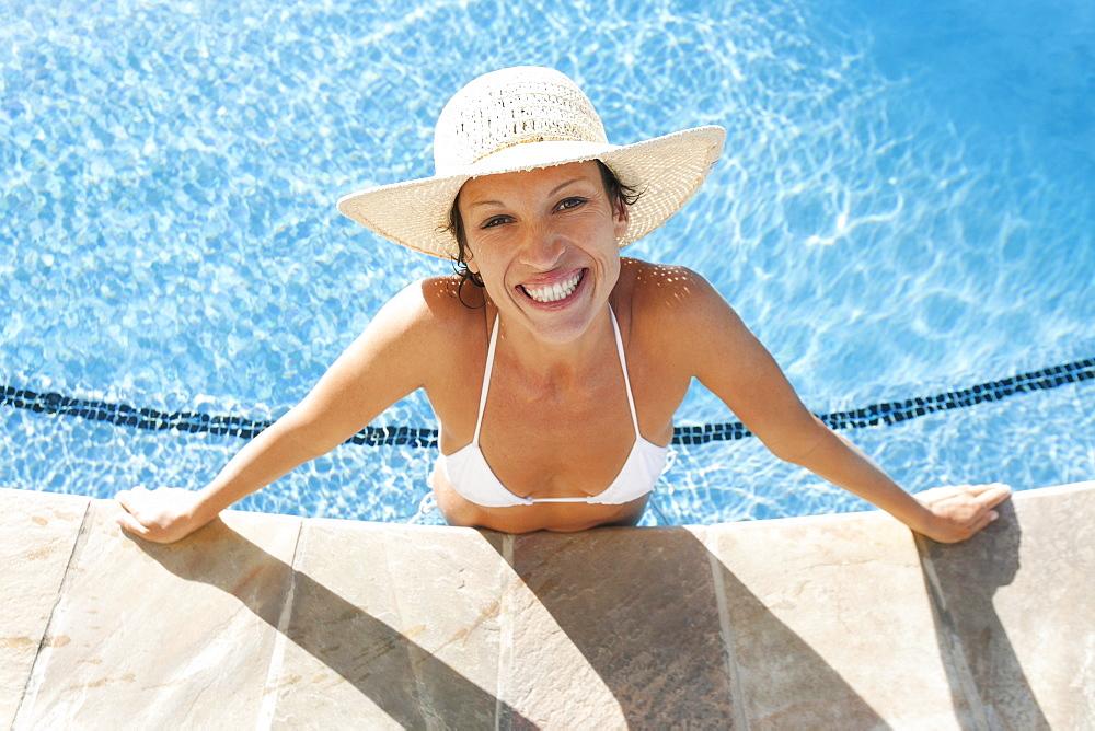 Hawaii, Woman enjoying a day at the pool.