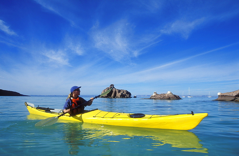 Mexico, Baja California Sur, Sea of Cortez at Espiritu Santo Island near La Paz, Woman sea kayaking.