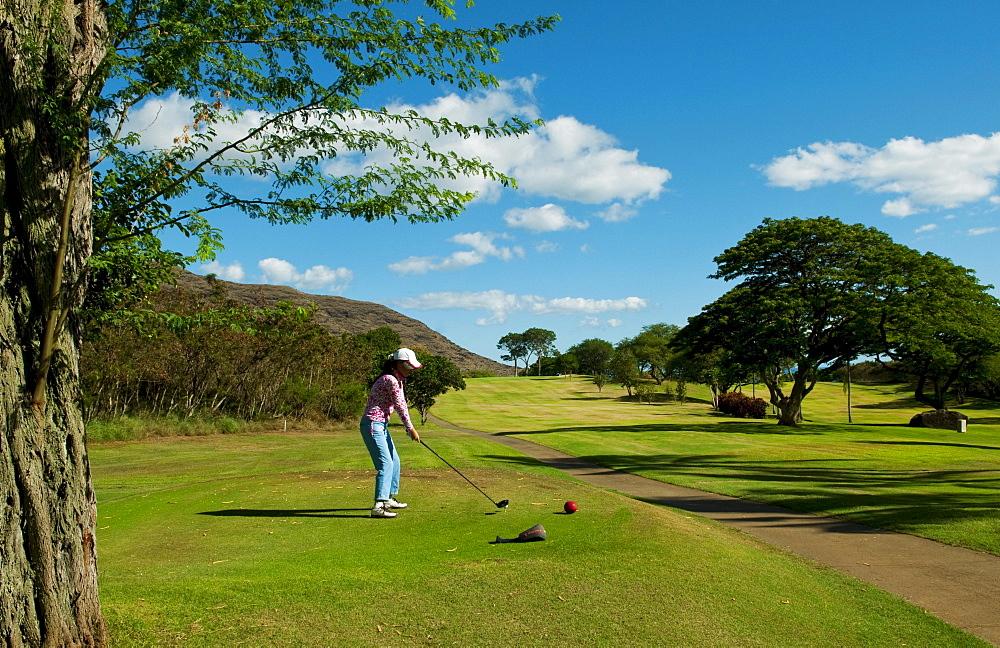 Hawaii, Oahu, Waianae, Makaha Resort, A Korean woman enjoys playing the 15th hole.