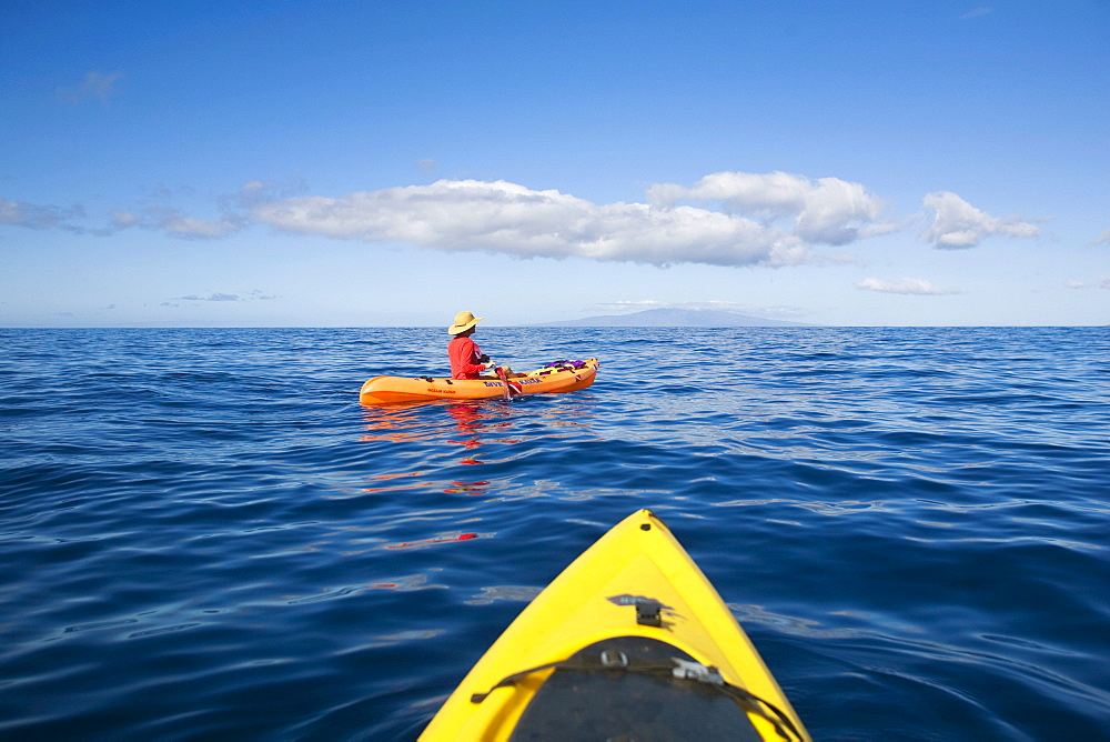 Hawaii, Maui, Kayakers on the south coast of Maui.