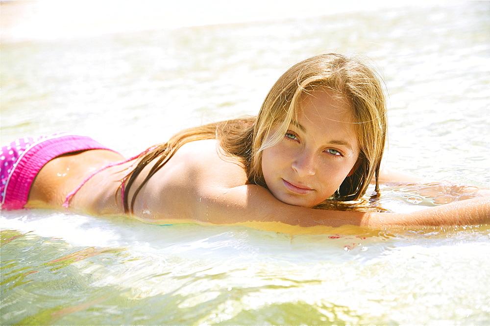 Hawaii, Kauai, Tunnels Beach, Surfer girl enjoying a day out.