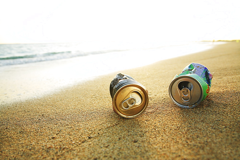 Hawaii, Oahu, Aluminum cans on the beach.