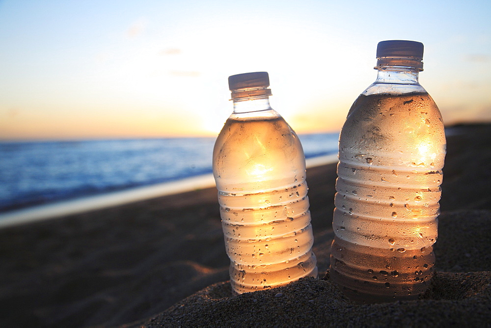 Hawaii, Oahu, Bottle of water on the beach.