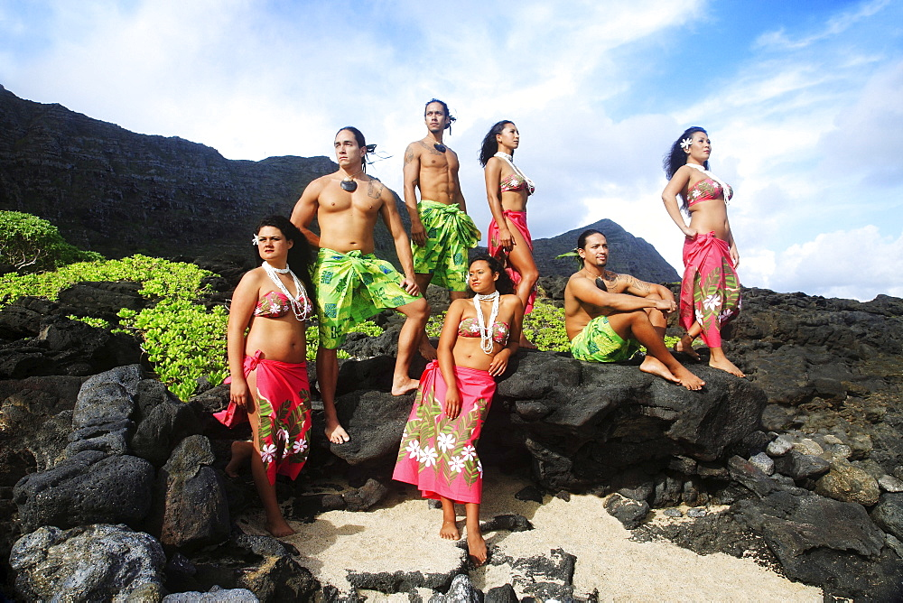 Hawaii, Oahu, Group of Tahitian Male and Female Dancers posing.
