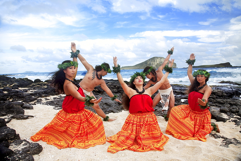 Hawaii, Oahu, Makapu'u Beach, Group of Tahitian Male and Female Dancers posing, Rabbit Island in background.