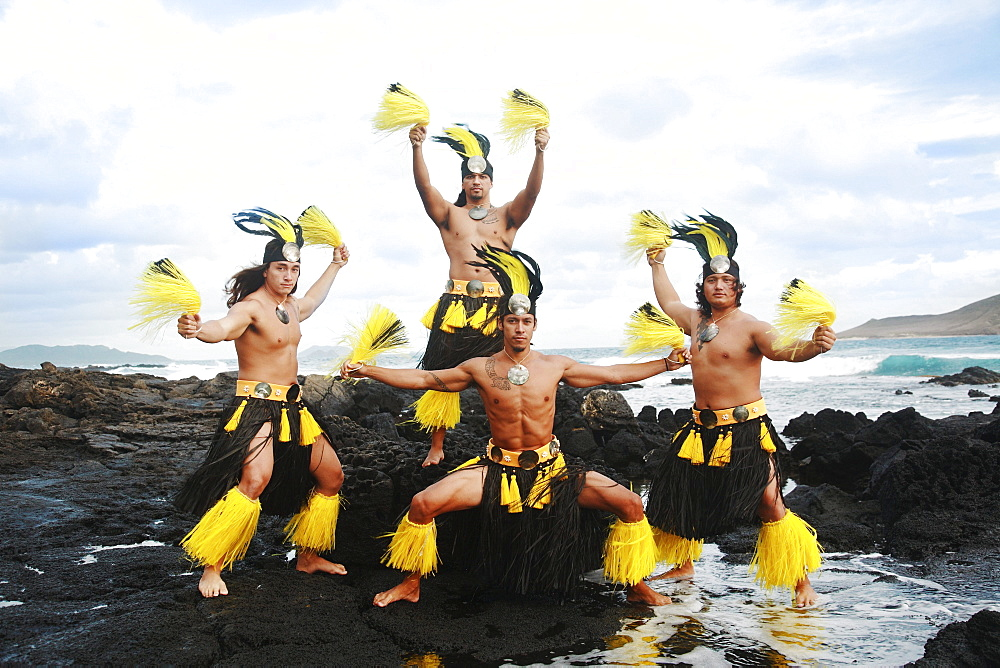 Hawaii, Oahu, Group of Tahitian Male Dancers posing.