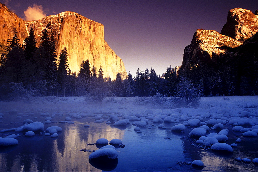 California, Yosemite National Park, Yosemite Valley, Sunset over El Capitan and snowy Merced River.