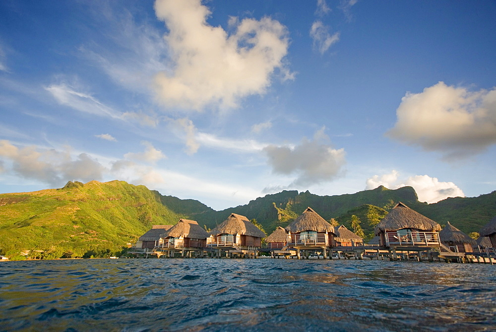 French Polynesia, Moorea Lagoon Resort, Bungalows over beautiful turquoise ocean.