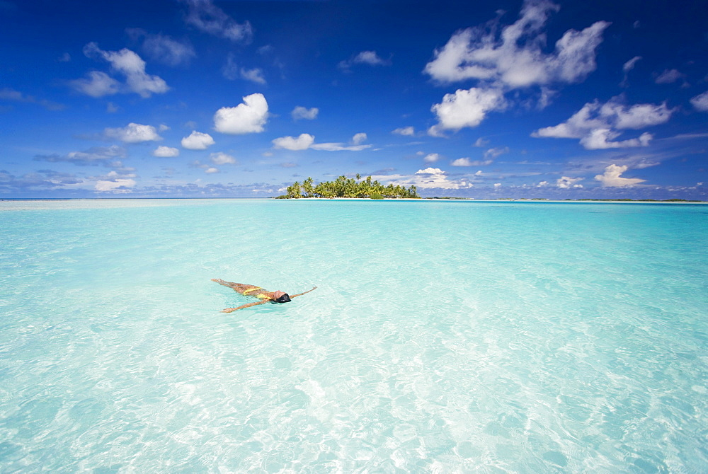 French Polynesia, Tuamotu Islands, Rangiroa, Woman enjoy a day in the ocean.
