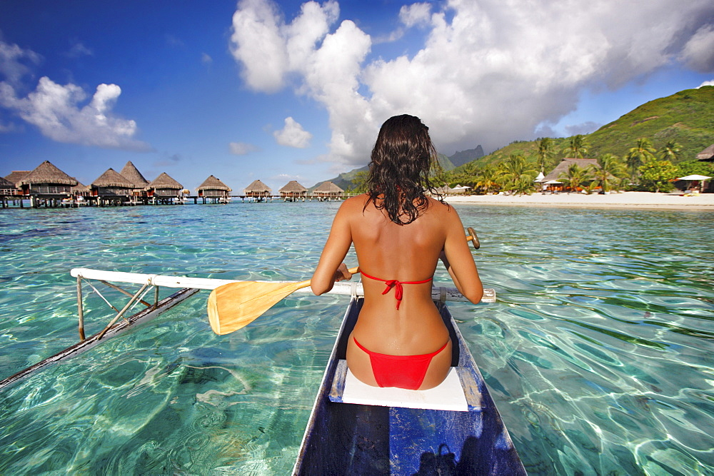 French Polynesia, Bora Bora, Female kayaker enjoying a day on the water.