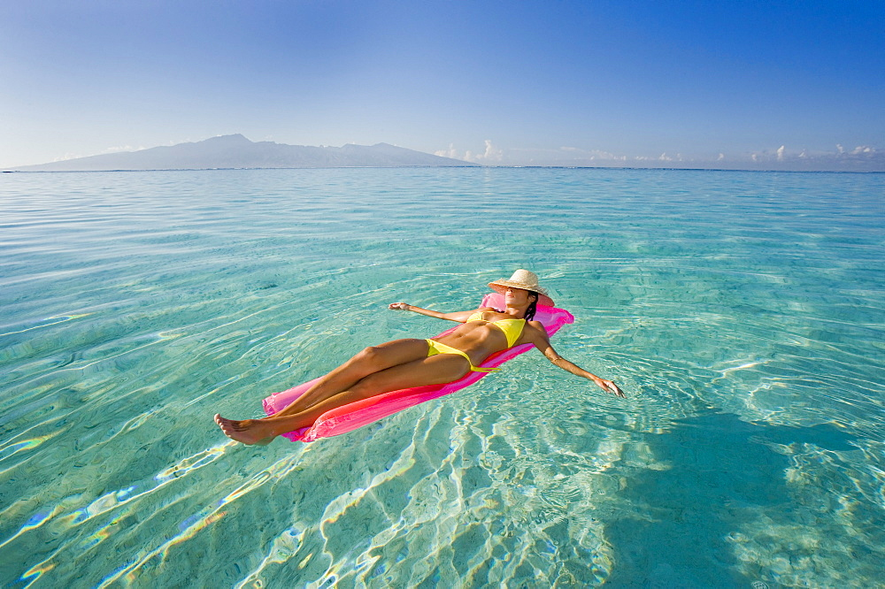 French Polynesia, Tahiti, Moorea, Woman floating in water.