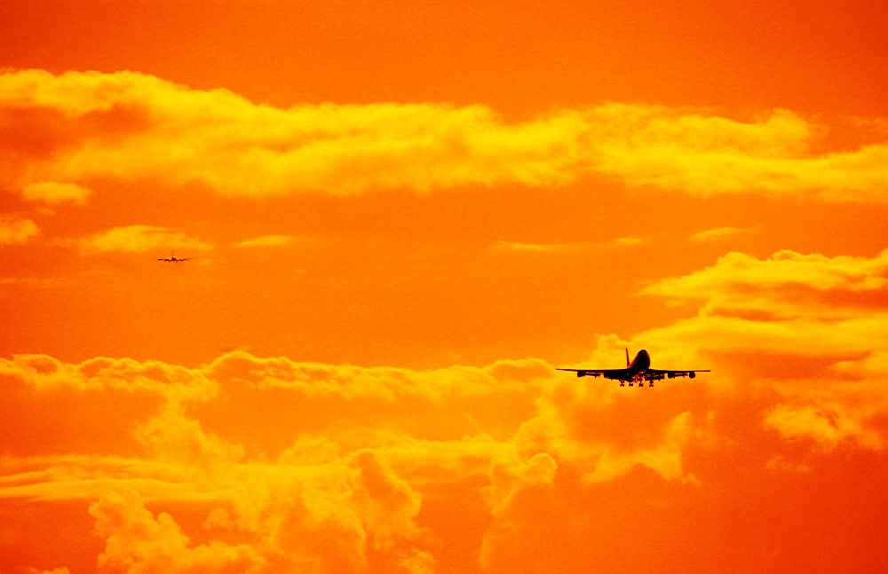 Hawaii, Oahu, Honolulu International Airport, Boeing 747 Jet Landing at Sunset.