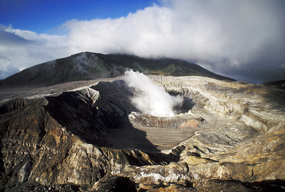 Costa Rica, Poas Volcano National Park, Steaming crater on mountain top, View from above.