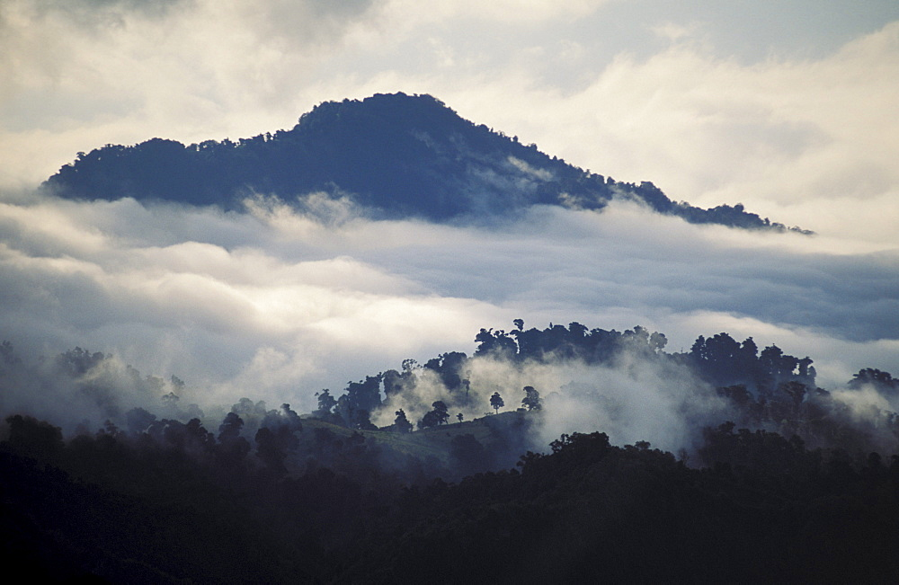 Costa Rica, Irazu National Park, Mountain surrounded by clouds.