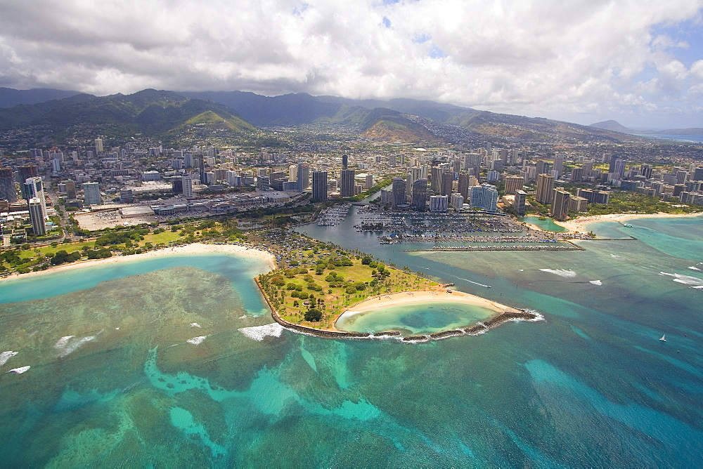 Hawaii, Oahu, Honolulu, Aerial of Magic Island, Ala Wai Yacht Basin and Ala Moana Beach Park.