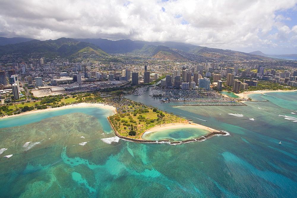 Hawaii, Oahu, Honolulu, Aerial of Magic Island, Ala Wai Yacht Basin and Ala Moana Beach Park.