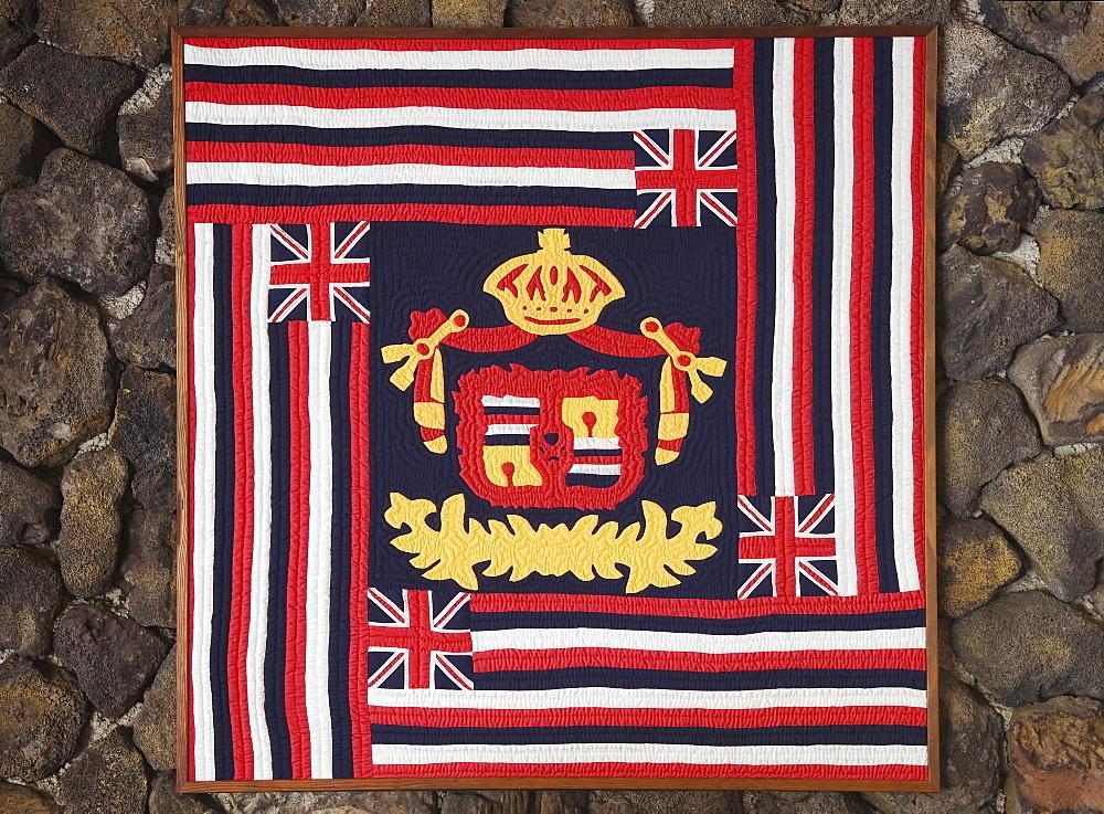 Hawaii, Big Island, Kailua-Kona, Kona Seaside Hotel, Hawaiian quilt with flag and royal crest design.