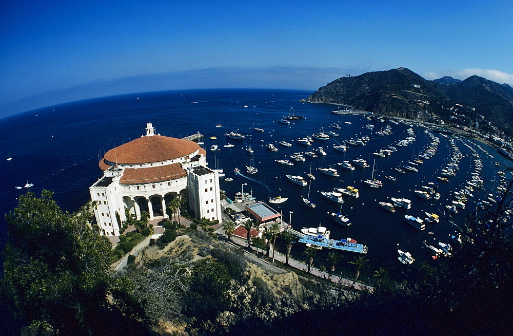 California, Catalina Island, Wide angle view of casino building and boats in harbor.