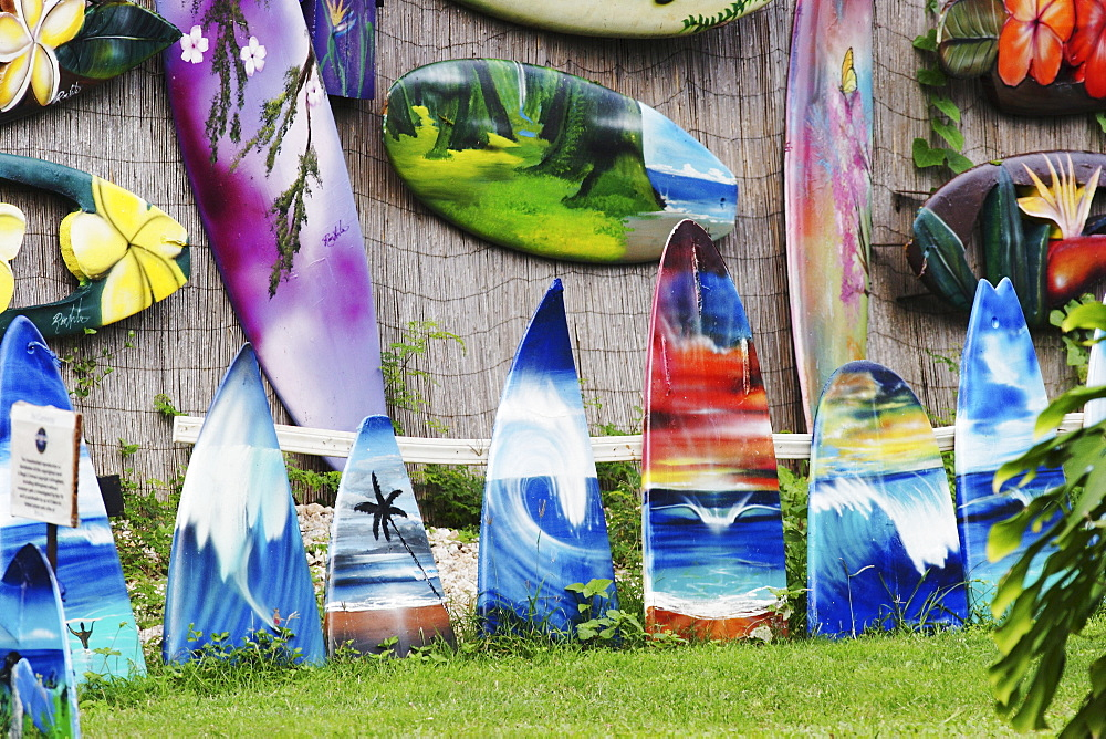 Hawaii, Oahu, North Shore, Haleiwa, Elaborately painted surfboards by Ron Artis.