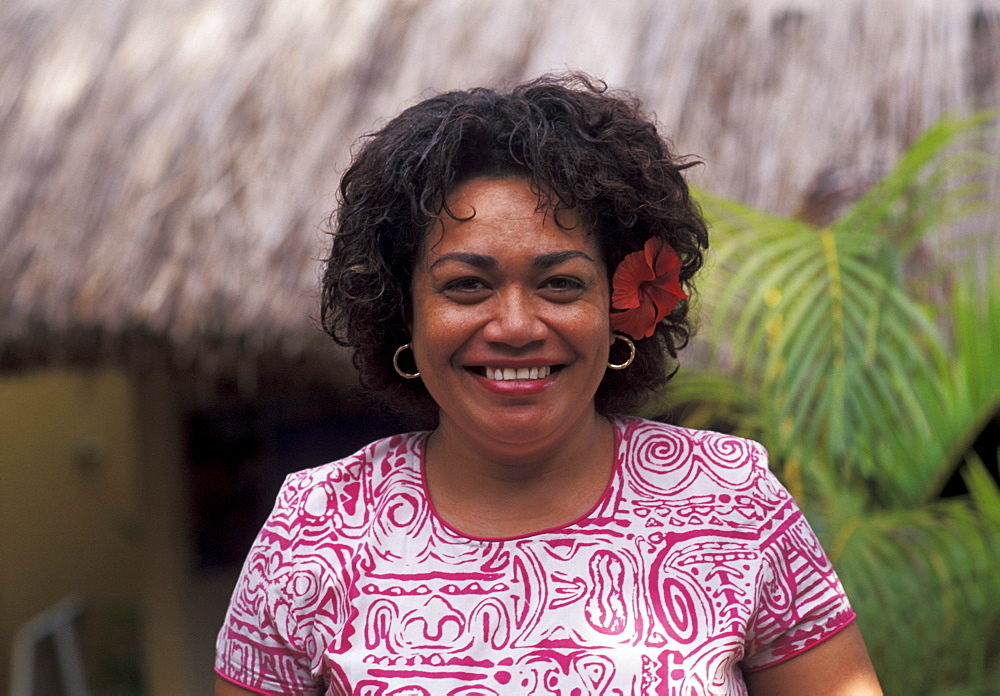 Fiji, Portrait of mature local woman in colorful dress.