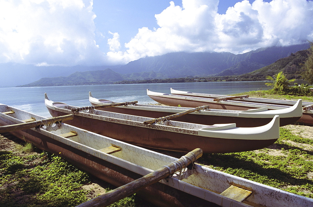 Hawaii, Oahu, Kaneohe Bay, Secret Island, Line of outrigger canoes on beach.